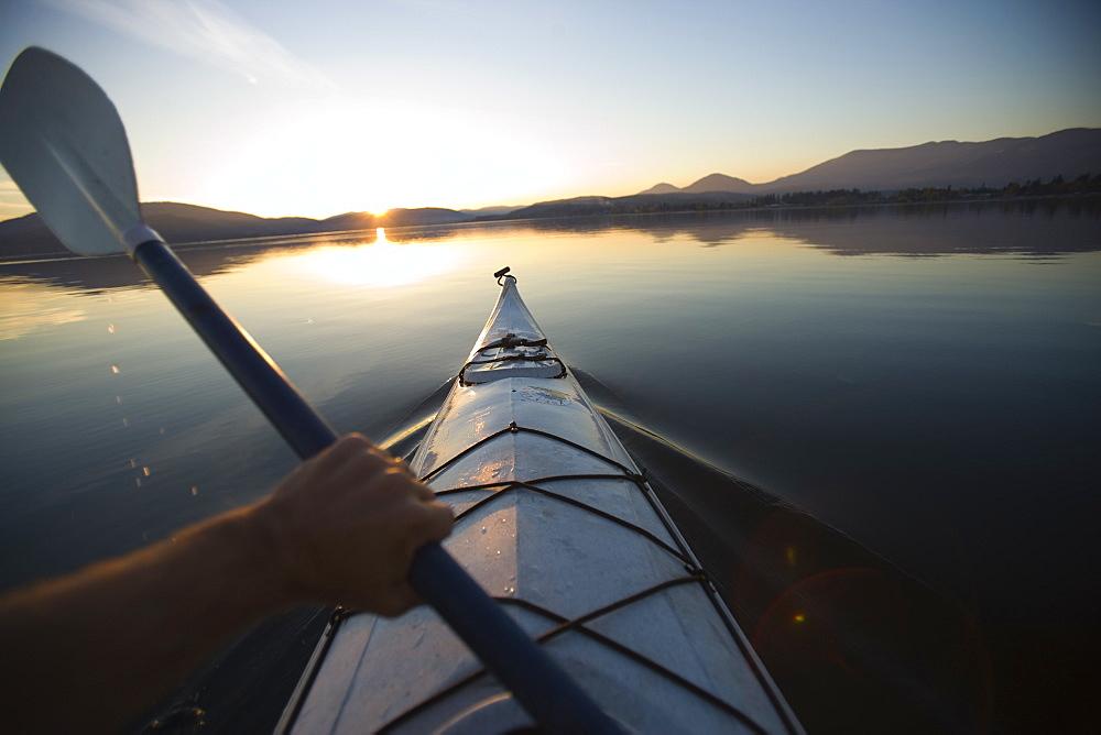 Sea Kayaking on calm lake during fall