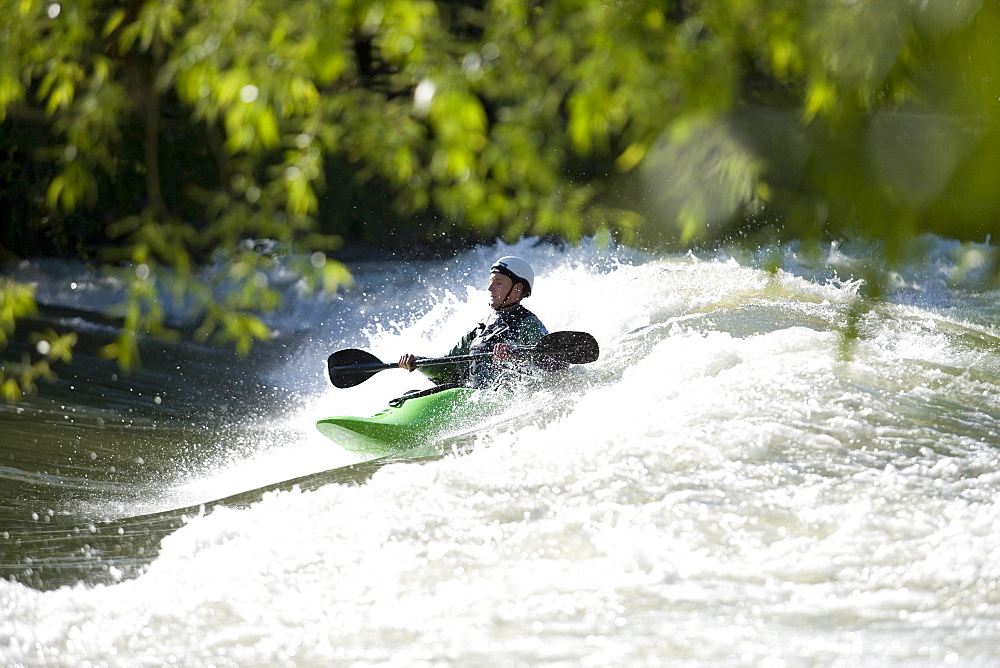 Kayaker surfing a standing wave