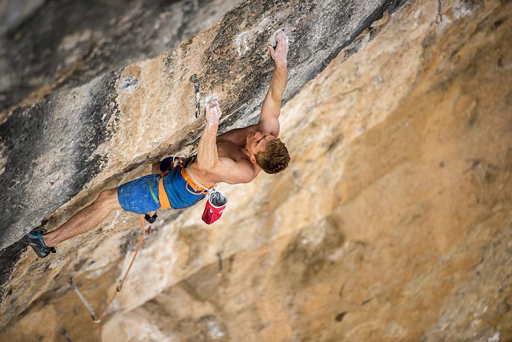 Nowegian climber Magnus Midtbø climbing Papichulo 9a+ in Oliana, Spain.