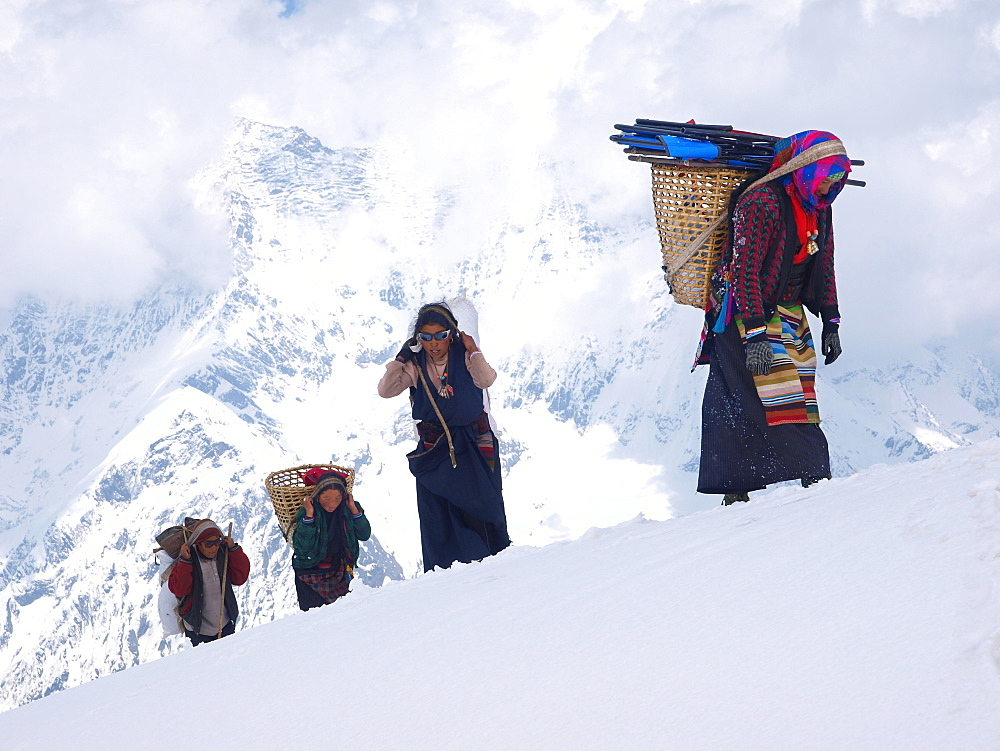Manaslu mountaineering expedition 2008, Nepal Himalayas: Porter are arriving in basacamp.