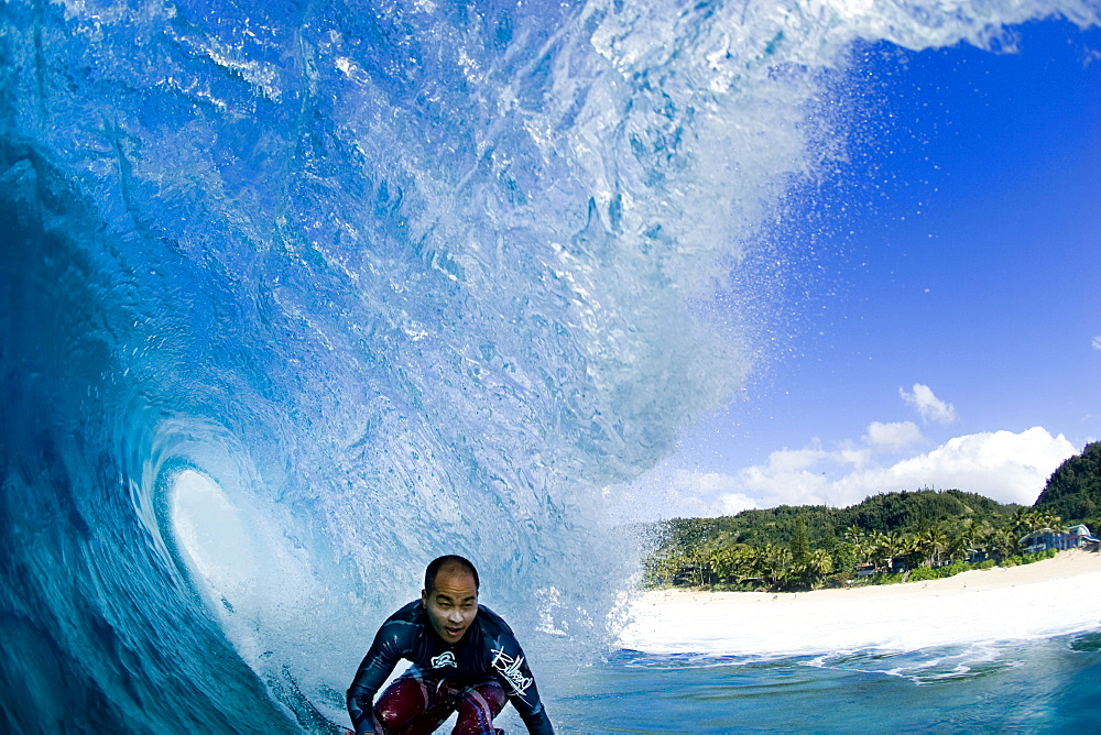 water view of surfing at Off The Wall, north shore,