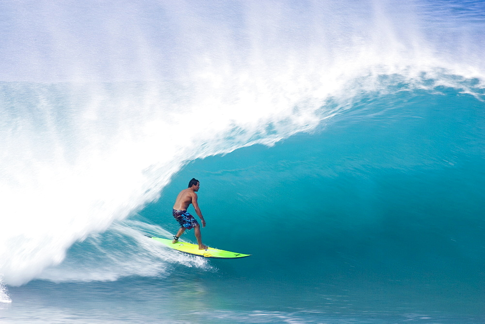 man surfing a large wave at Pipeline, on the north shore of Oahu, Hawaii ,