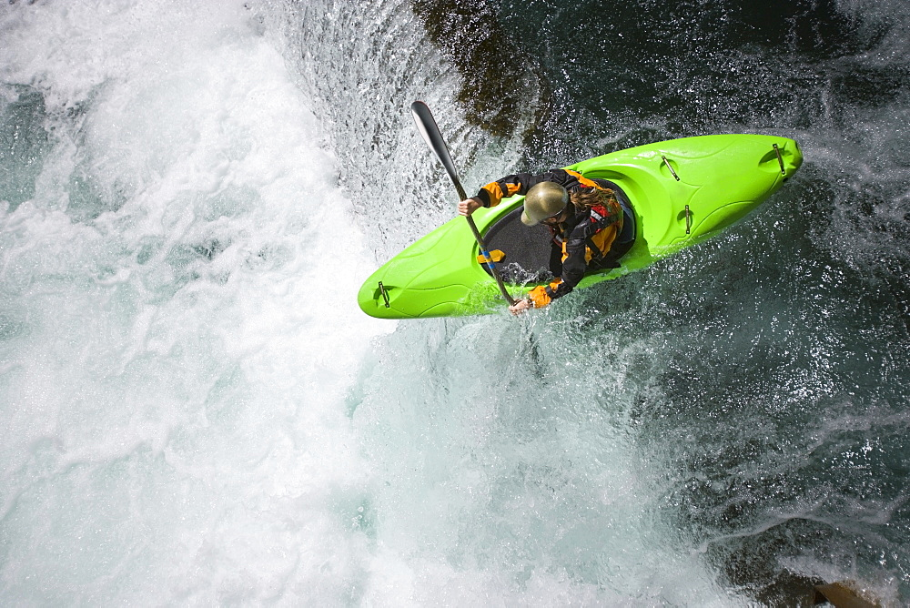 An expert whitewater kayaker runs Shepherds Falls on the Wind River near Carson, Washingon