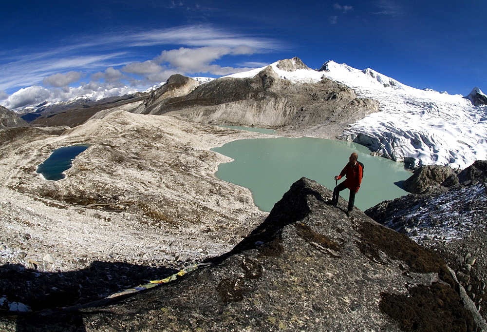 A lone hiker stands atop a Himalaya pass in Bhutan