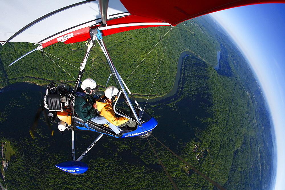An Light Sport aircraft flies over the New River Gorge, WV
