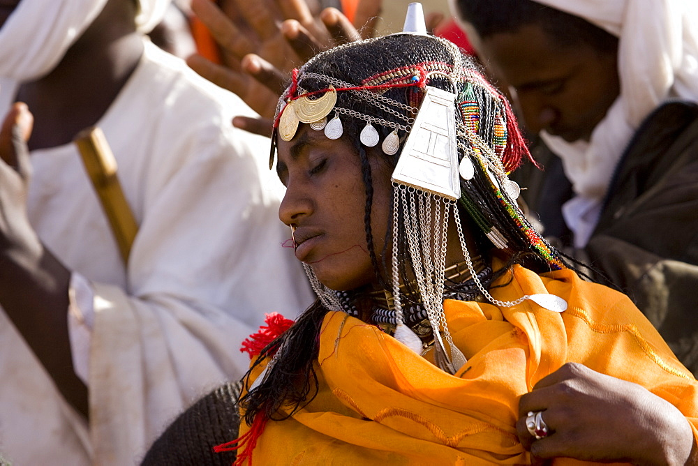 Shanabla woman dances  at a wedding celebration near El Obeid, North Kordofan, Sudan. A nomadic tribe they raise camels.
