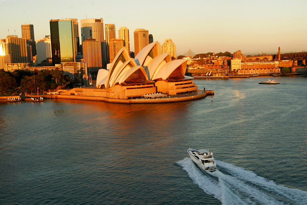 Motor yacht in the bay of Sydney during sunrise.