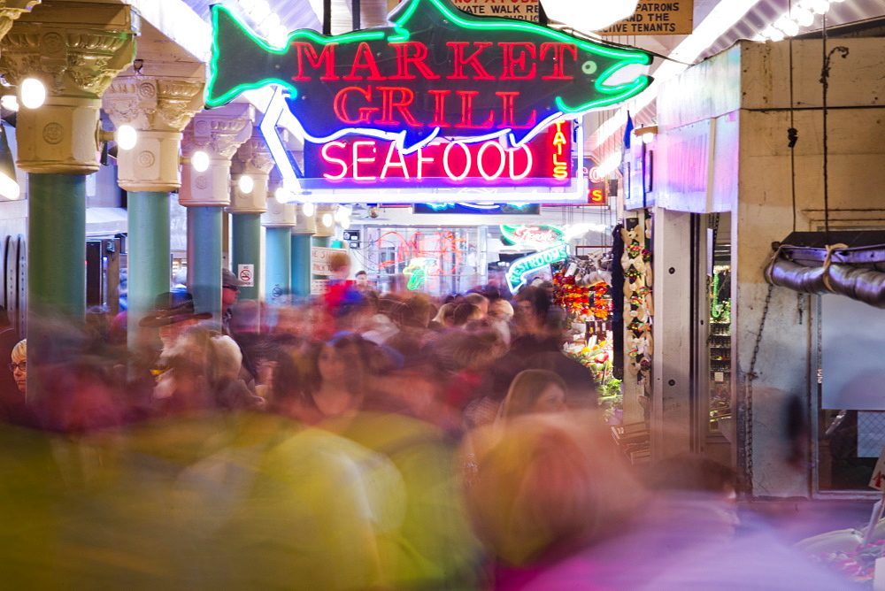 Crowds of people walk through Pike Place Market in Seattle, Washington. (motion blur)