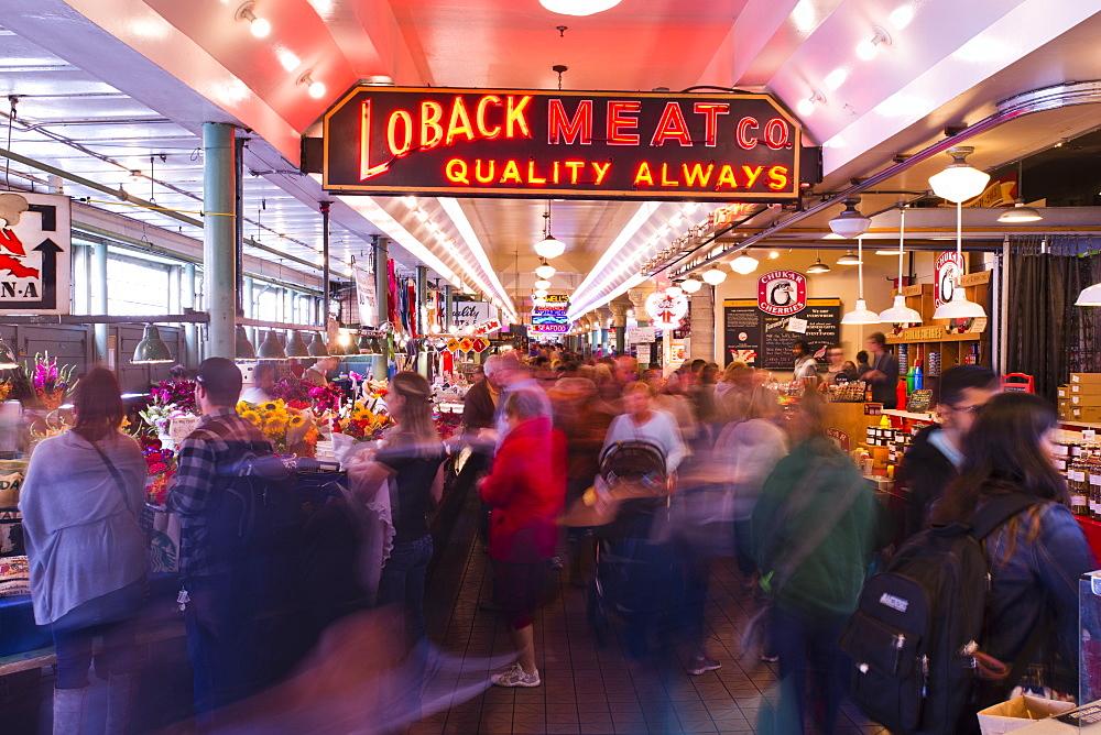 Crowds of people walk through Pike Place Market in Seattle, Washington. (motion blur)
