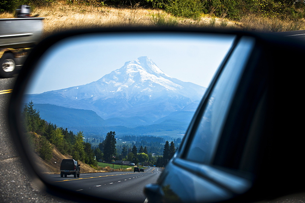 Snow capped Mt. hood is seen in the rearview of a car outside Hood River, Oregon.