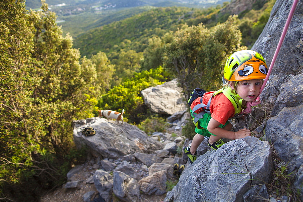 A little boy, a little climber in Corsica. 3 years old.