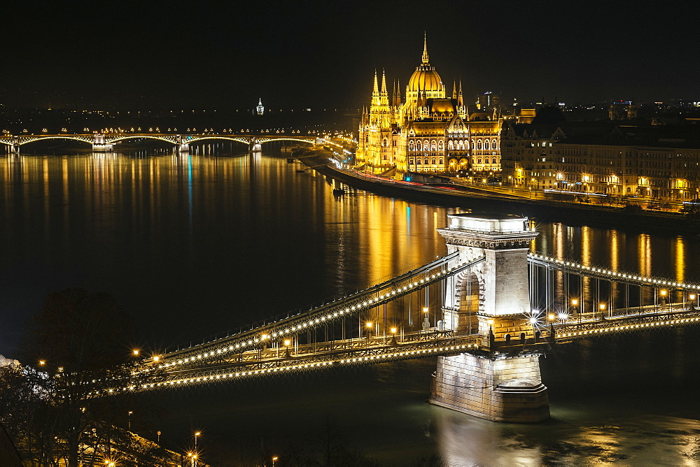 Night photo of the Parliament and the bridges in Budapest from across the Danube river