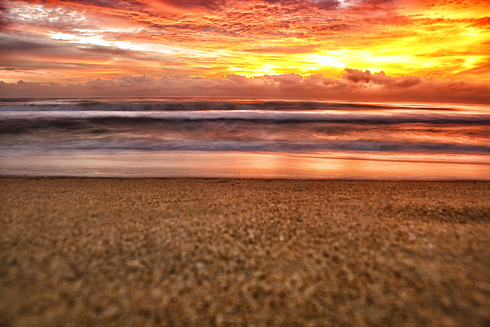 Golden Sunrise over the Indian Ocean at Nilaveli near Trincomalee on Sri Lanka's East Coast.