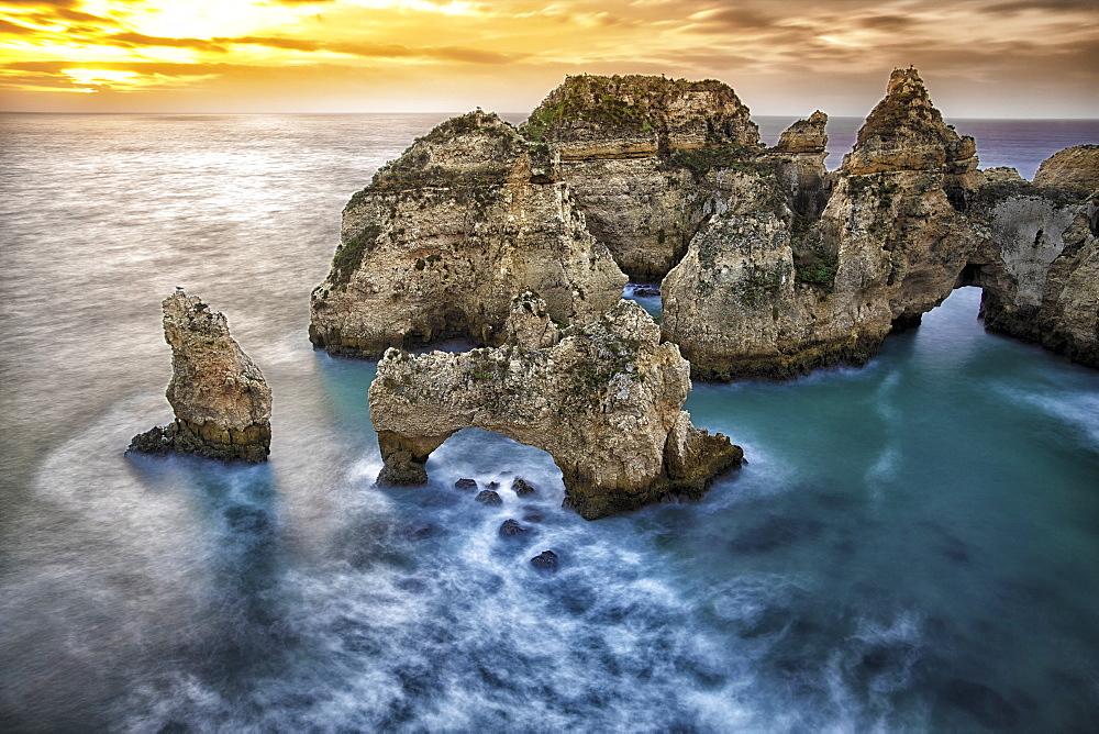 Ponta da Piedade sea stacks and arches captured at sunrise, Portugal.