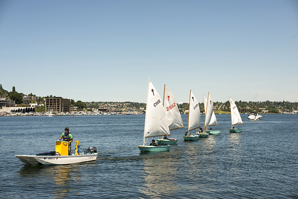 Children learn to sail in Lake Union in Seattle, Washington on June 7, 2014.