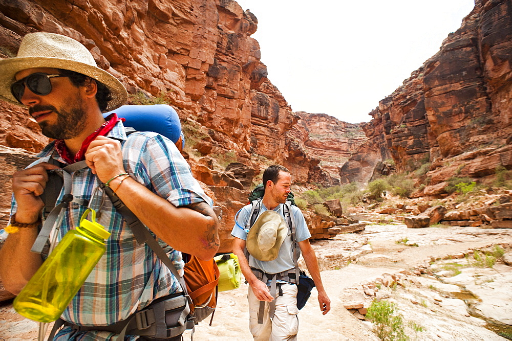 Two backpackers hiking through the Grand Canyon.