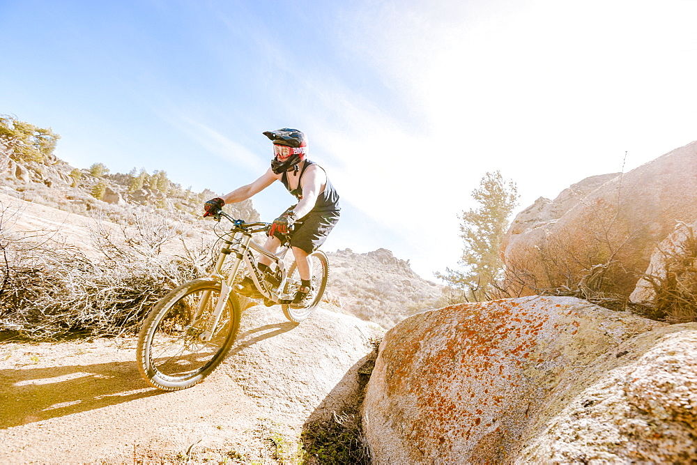 Man Mountain Biking On Rocky Landscape In Gunnison