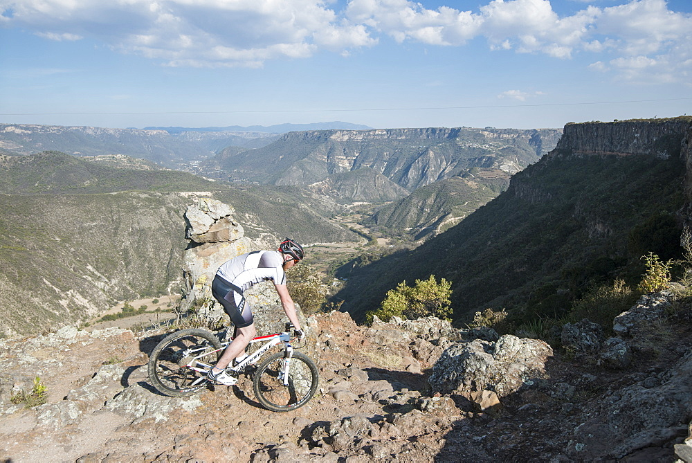 Mountain Biker Descending A Rocky Trail In Mexico