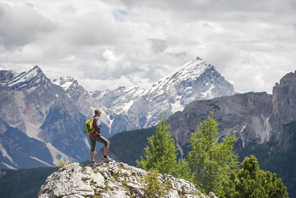 Female Hiker Standing On Rock In Cinque Torri Area At Dolomites, Italy