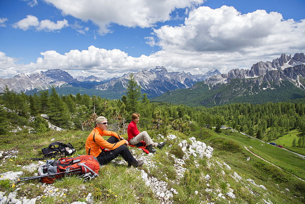 A Couple Taking Rest At The Cinque Torri Area In The Dolomites, Italy - 857-93147