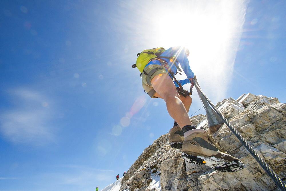 Low Angle View Of Woman Climbing Down At The Via Ferrata Ivano Dibona