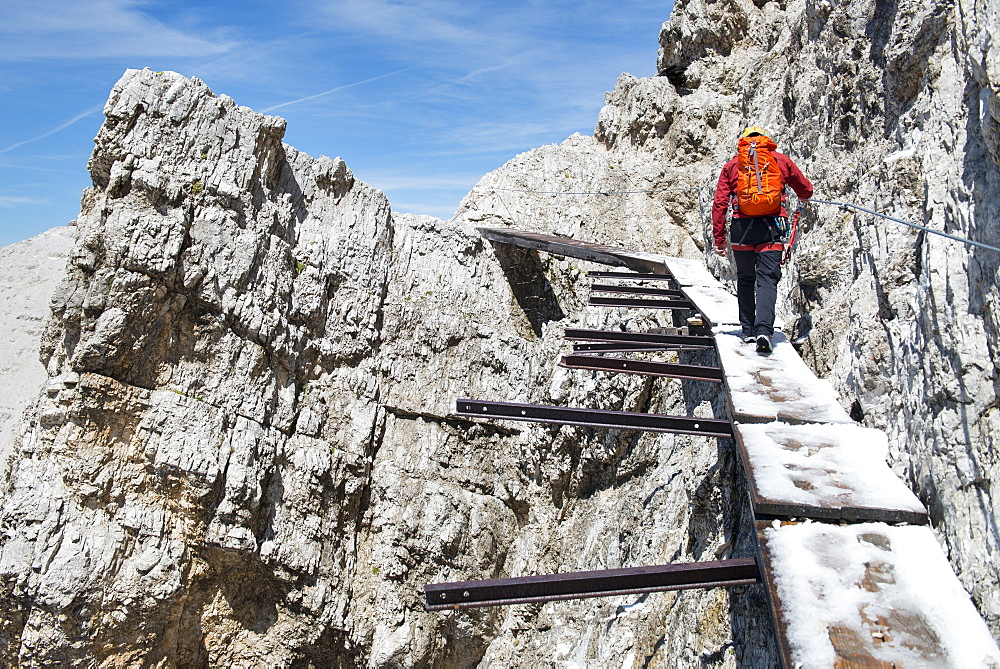 Man Walking Through An Old Bridge At The Via Ferrata Ivano Dibona