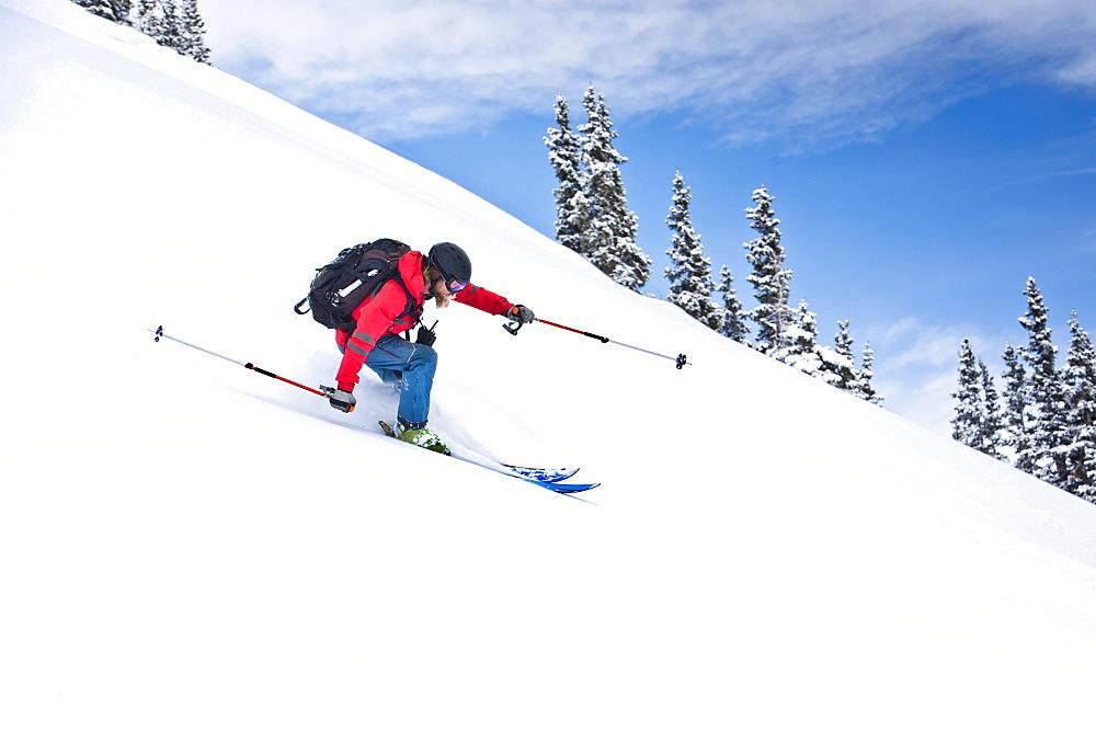 A Skier Riding Through Powder At Silverton, Colorado