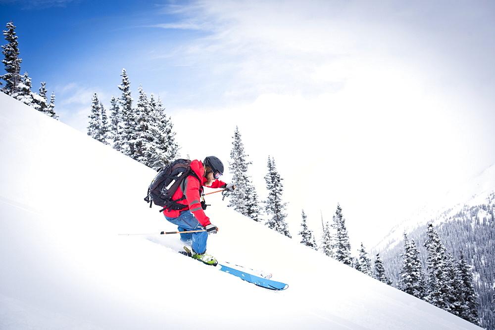 Skier Skiing On Snowy Slope In Silverton, Colorado