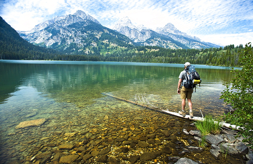 A Backpacker Looking At The Grand Teton Mountains, Jackson Hole, Wyoming