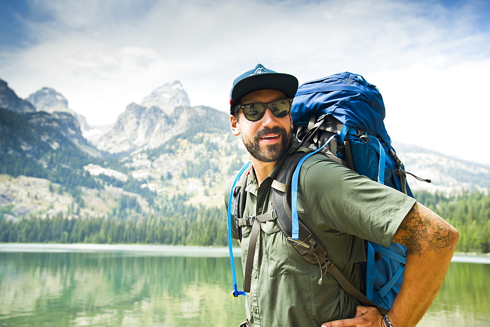 Portrait Of A Backpacker In Front Of The Grand Teton Mountains In Jackson Hole, Wyoming