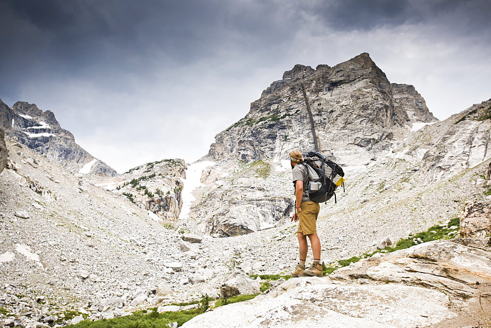 A Backpacker Looking At Teton Mountains In Jackson Hole, Wyoming