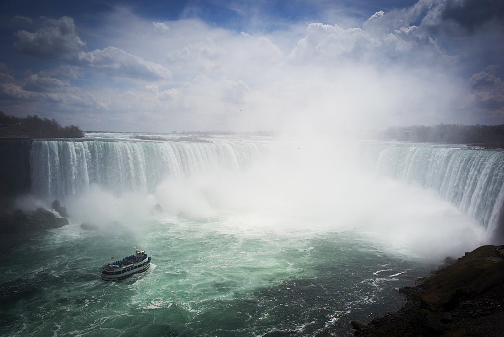 A Ship Carrying Tourists Tours At Niagara Falls In Ontario, Canada