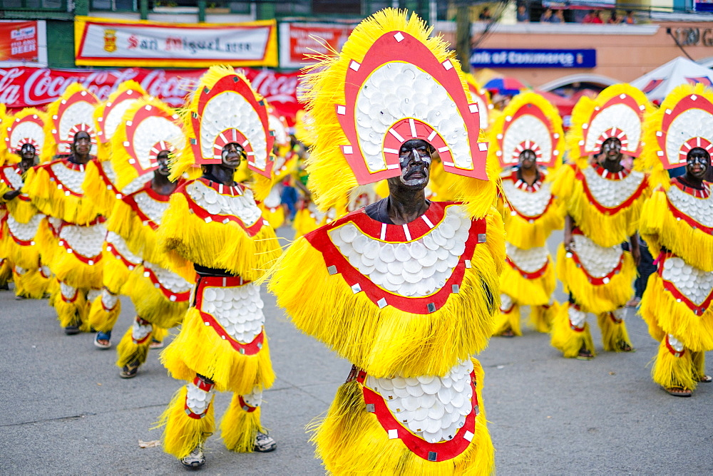 Ati Atihan Parade Wearing Brightly Colored Home-made Costume In Philippines