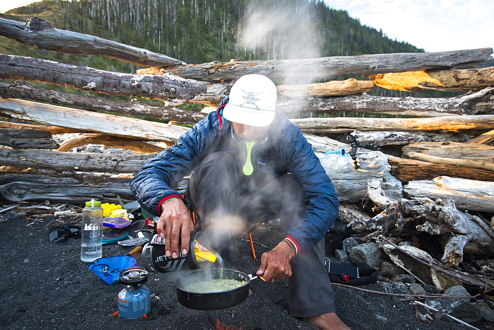 A backpacker cooks dinner at his campsite on the Lost Coast