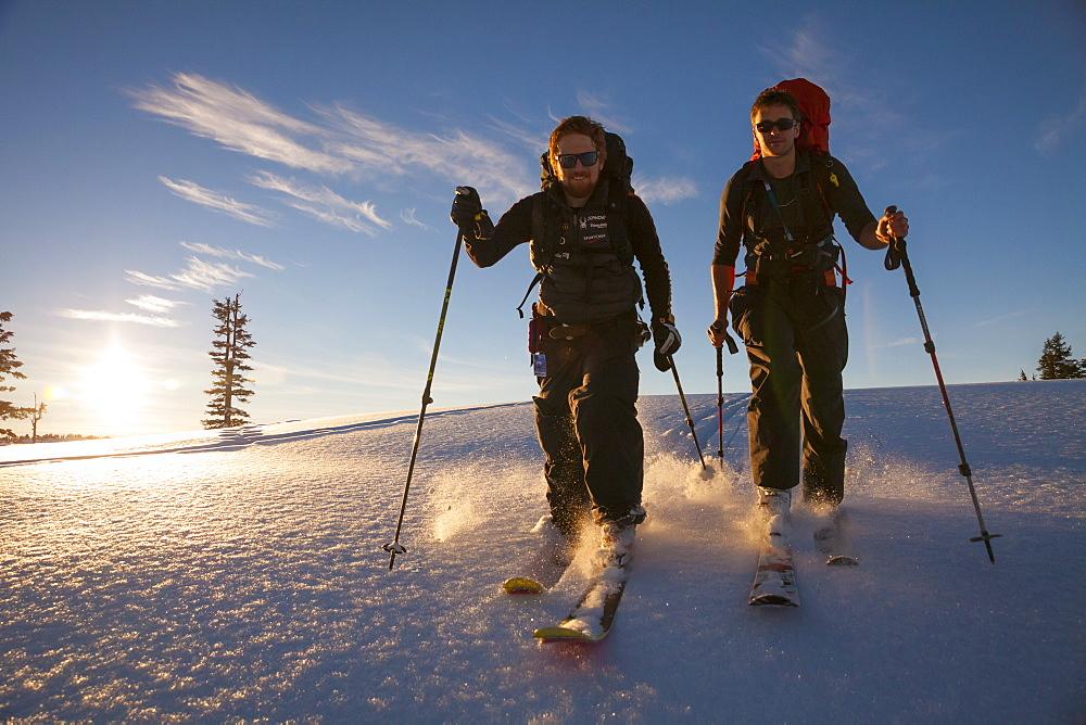 Two People Ski Touring Through Fresh Snow In Garibaldi Provincial Park, Canada
