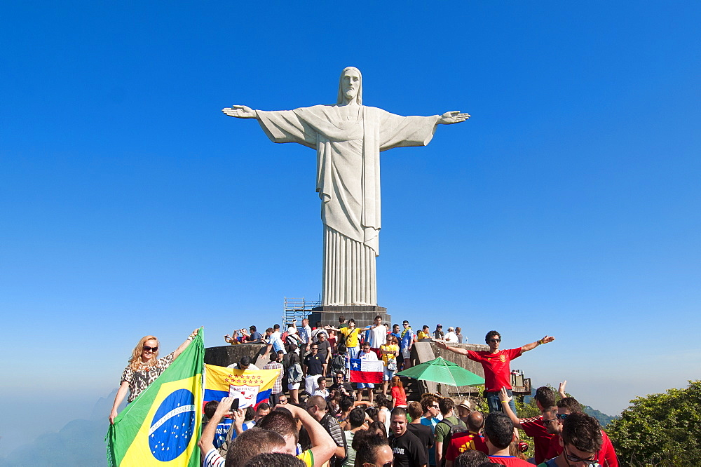 A crowd of people at Christ the Redeemer statue on Corcovado mountain
