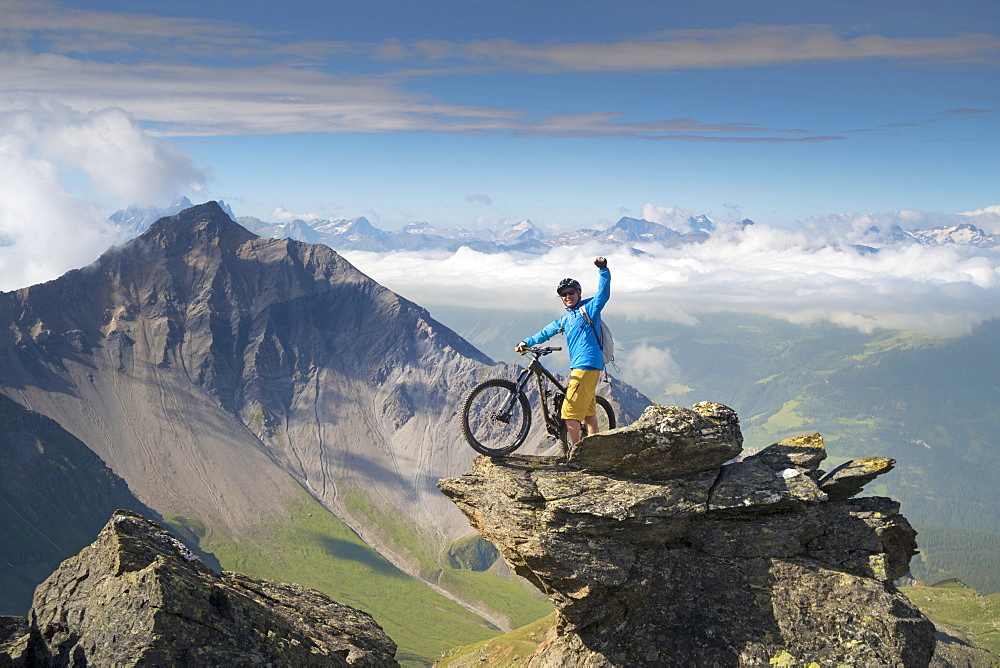 Successful Mountain Biker Reach The Top Of Mountain In Switzerland