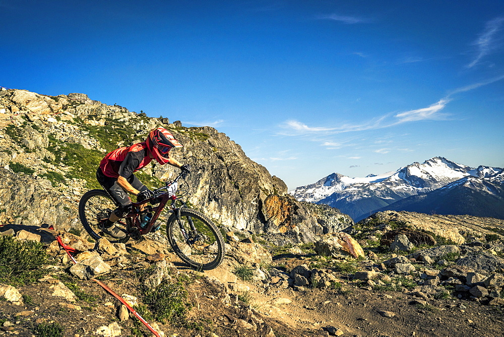 Mountain Biker Riding On The Top Of The World Trail In Whistler, British Columbia