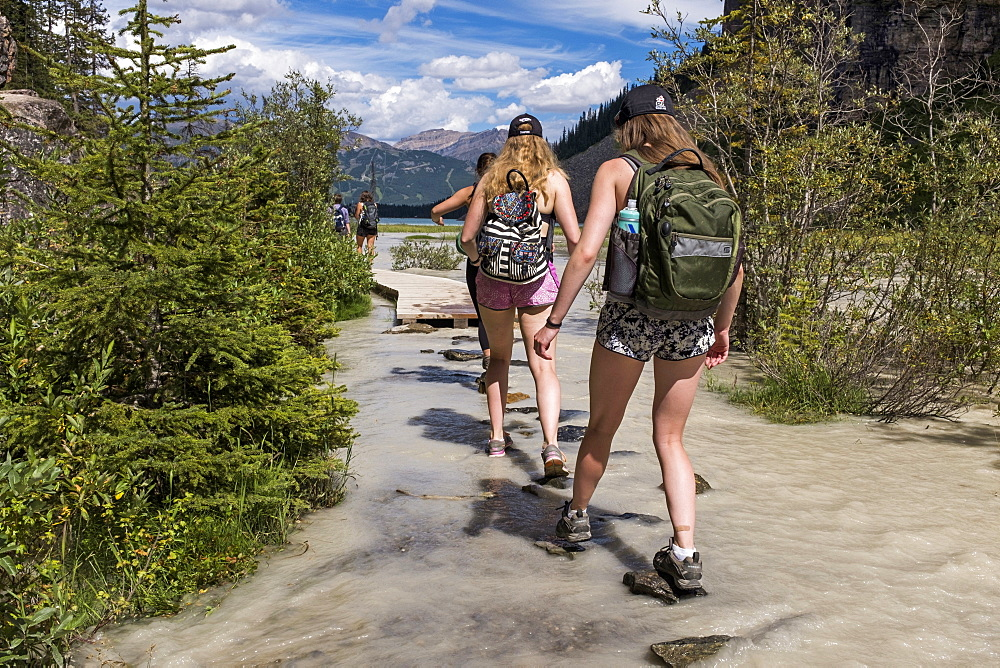 Female Hikers On A Trail Near Lake Louise In Banff National Park, Canada