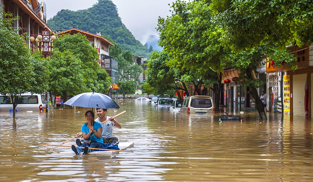 Couple Floating On A Raft During The Floods In Yangshuo