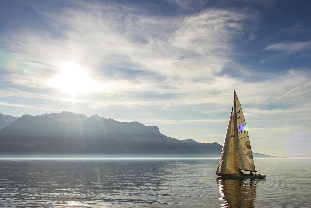 A Sailboat Gliding Over Lake Geneva On A Sunny Day