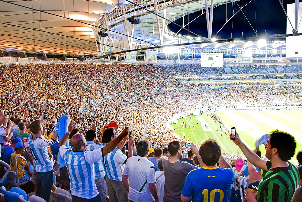 Soccer Fans Cheering And Taking Pictures With Their Smart Phones In Maracana Stadium