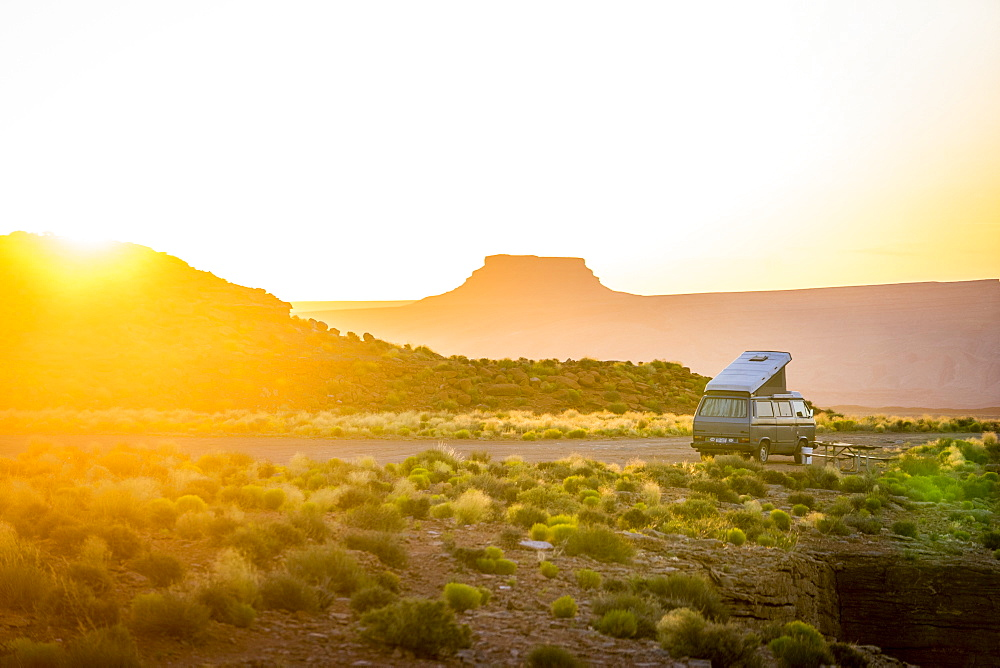 Camper Van In Goosenecks State Park During Sunrise