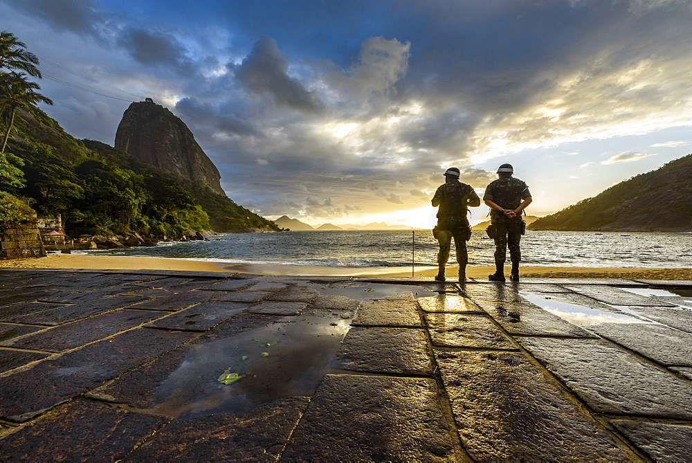 Two Military Soldiers At Praia Vermelha Beach During Sunrise