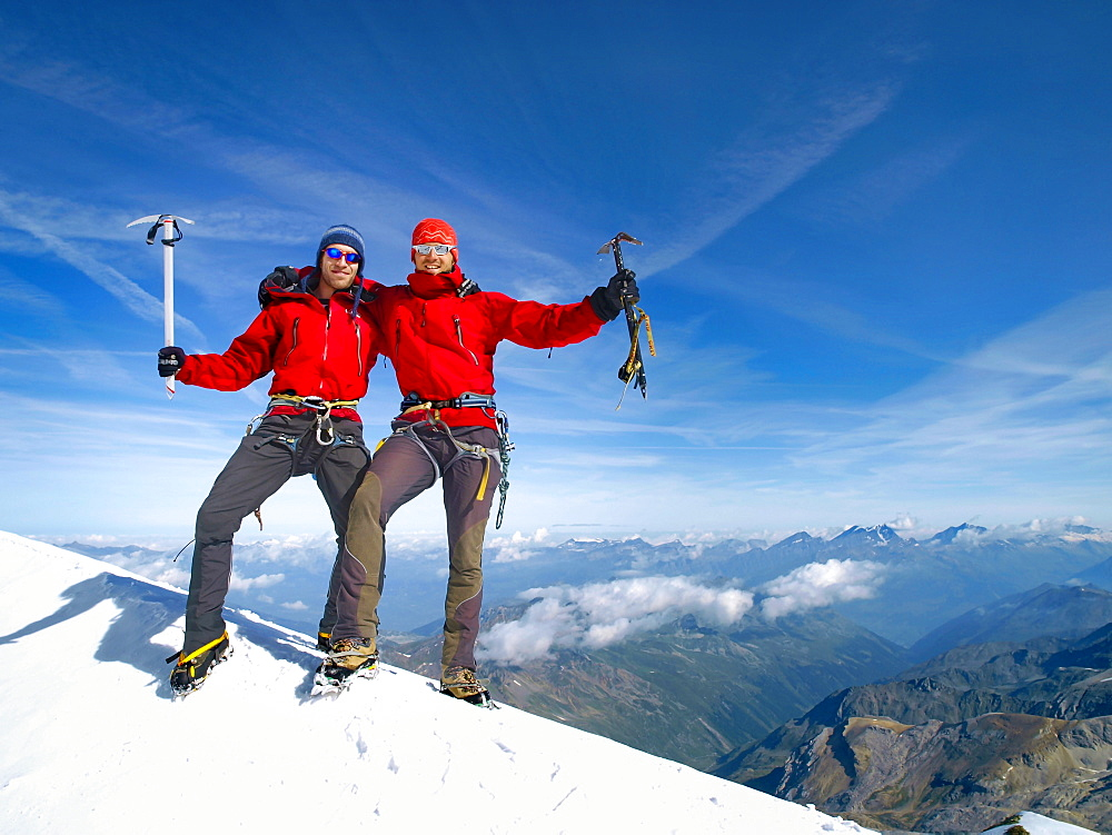 Two Happy Alpine Climbers On The Summit Of The Bishorn