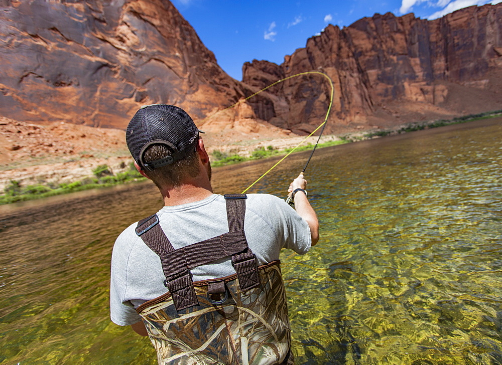 Man Casting In Horseshoe Bend On The Colorado River