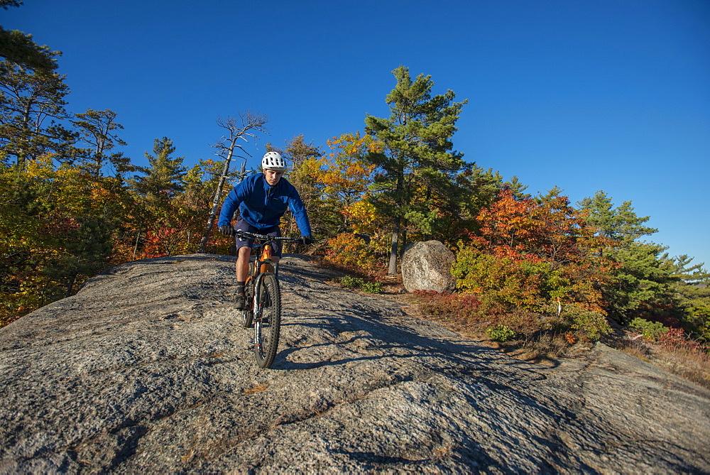 Mountain Biker Riding On The Bare Granite Slabs