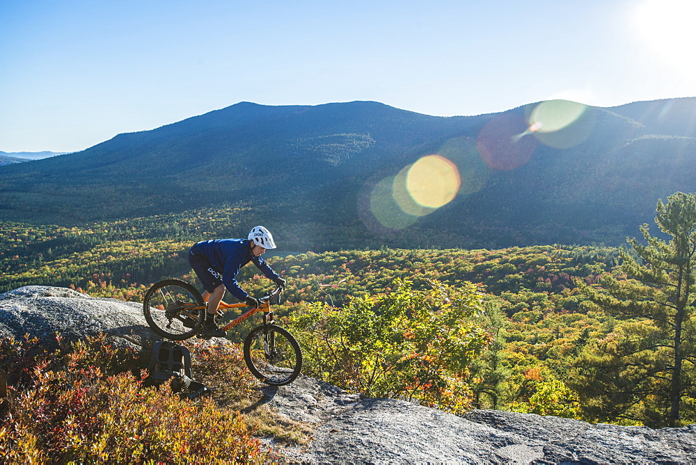 Mountain Biker Riding On The Bare Granite Slabs Of The Whitehorse Ledge, New Hampshire