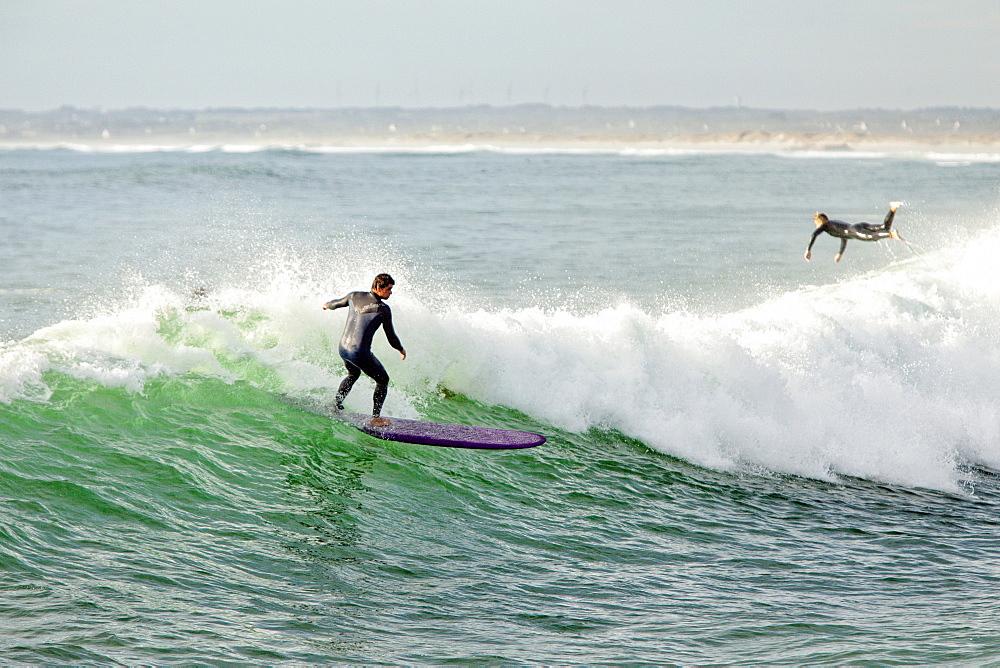 Surfboarding On The Waves Of Mediterranean Beach