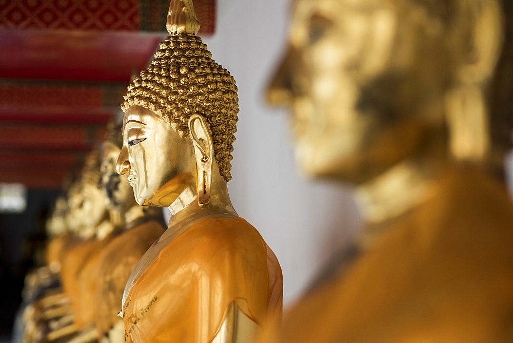 Row Of Golden Buddha Statues At The Wat Pho Temple, Bangkok, Thailand
